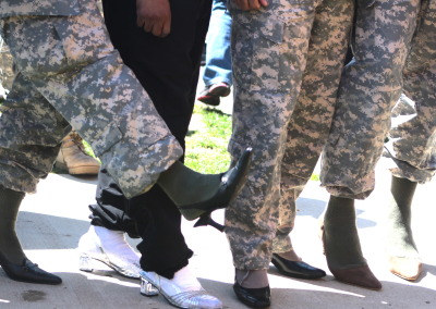 """In recognition of Abuse towards female specifically, sexual abuse, Soldiers participated in an event called, """"Walk A Mile In Her Shoes,"""" to express their support."""